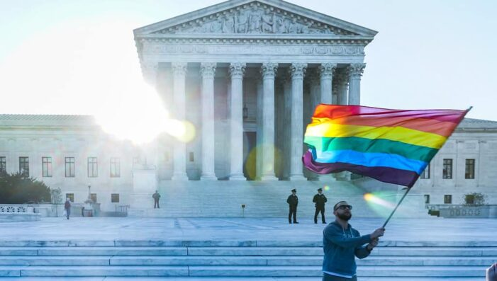 LGBTQ Flag Waved Outside of Supreme Court - Photo by Ted Eytan